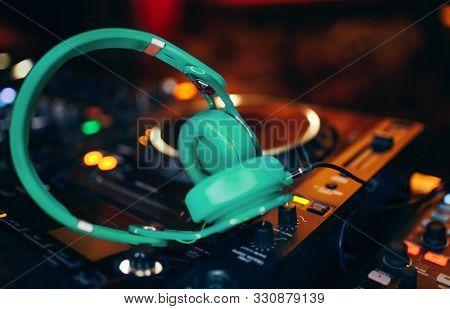 Closeup Pair Of Aqua Blue Emerald Green Headphones For Dj.cd Mp4 Music Deejay Mixing Desk Music Part