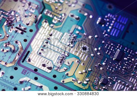 Electronic Circuit Board With Electronic Components Such As Chips Close Up. The Concept Of The Elect
