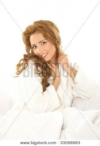 Morning concept: young attractive woman in the bed