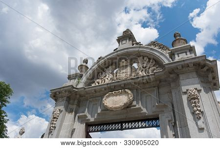 One Of The Entry Arcs To Parque Del Buen Retiro In Front Of Blue Sky, Madrid
