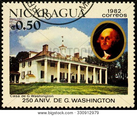 Moscow, Russia - October 30, 2019: Stamp Printed In Nicaragua Shows House Of First Us President Geor
