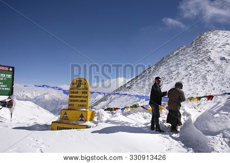Tibetan And Indian People Tie Prayer Flags Or Mantra Flag At Top Of The World Of Khardung La Road In