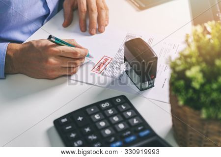 Office Worker Accepting And Signing Procurement Bill