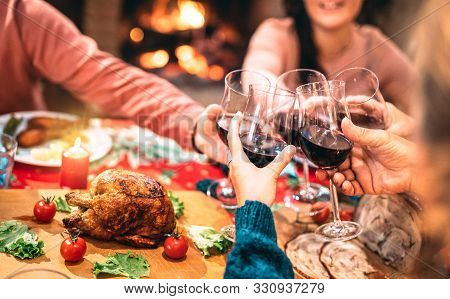 Family Toasting Red Wine And Having Fun At Christmas Supper Party - Holiday Celebration Concept With
