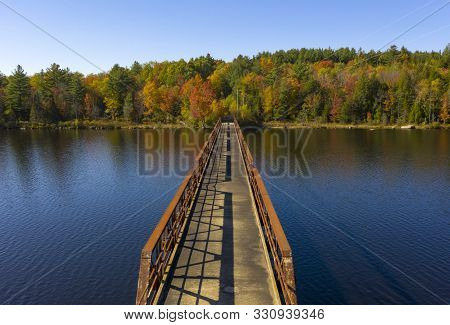 Fall Color Has Begun To Appear In The Trees Around A Like In The Adirondacks