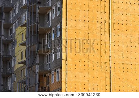 Construction Of A High Residential Building And Insulation Of Its External Wall With Special Heat-in
