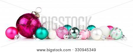Christmas Border Of Pink, Teal And White Ornaments. Side View Isolated On A White Background.