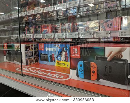 Honolulu -  October 30, 2018:  Nintendo Switch And Games Like Fortnite, Just Dance, Kirby, Fifa On D