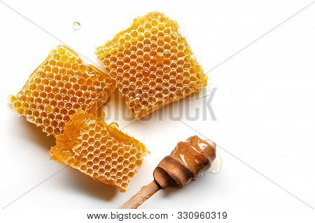 Fresh Honeycomb With Honey Spoon Isolated On White Background.