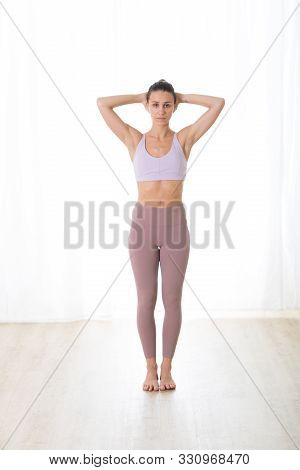 Portrait Of Gorgeous Active Sporty Young Woman Practicing Yoga In Studio. Beautiful Girl Practice Pr