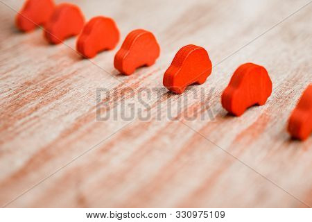 Competition, rivalry background. Race conceptual. Red objects in the row. Toy cars in the range on wooden background. Business concept. Tender idea. Qual opportunities poster