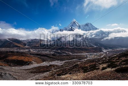 Wide Angle View To Ama Dablam 6814m Peak Covered With Clouds And Chukhung Village 4730m Liying On Im
