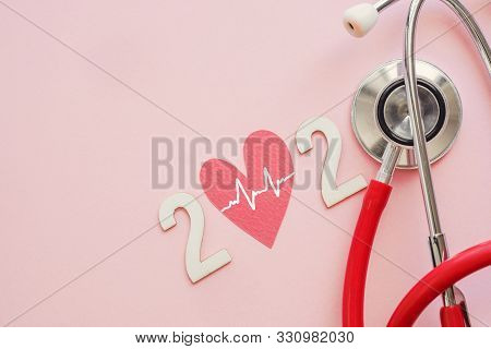 2020 Wooden Number With Red Stethoscope. Happy New Year For Heart Health And Medical Concept, Life I