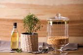 Jar with split peas on table against wooden background. Foodstuff for modern kitchen poster