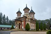 Sinaia Monastery, located in Sinaia, in Prahova County, Romania. Stone religious building of Christian Orthodox church built in the Byzantine style. poster
