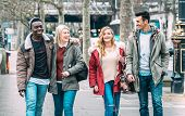 Multiracial group of millenial friends walking at London city center - Next generation friendship concept on multicultural young people on winter fashion cloth having fun together - Soft azure filter poster