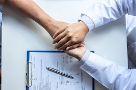 Hand Of Doctor Touching Patient Reassuring For Encouragement And Empathy To Support While Medical Ex