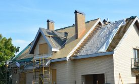Roofing Contractors Installing House Roof Asphalt Shingles. Roofing Contractor Repair Roofing Constr