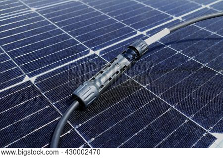 Solar Pv Connectors Male And Female Connected Together Laid On Solar Panel Surface