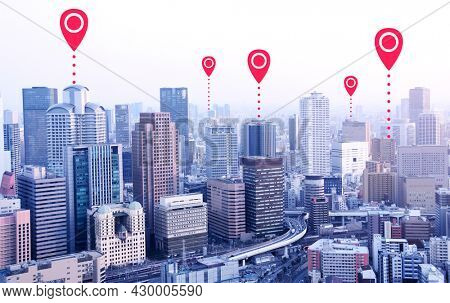 Network connection concept. Aerial view on Osaka with red location pin. Global positioning system pin map. Map pins with Osaka city, Japan