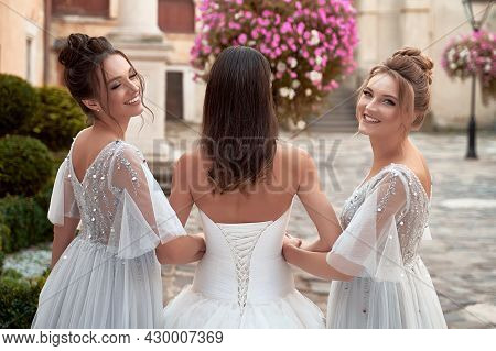 Beautiful Bride And Bridesmaids. Wedding Day In Old Beautiful European City.