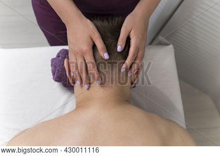 Masseur Does Neck Massage To Man In Spa Salon. Man Having Professional Wellness Massage. Head And Ne