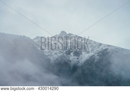 Wonderful View To Mountain Silhouette With Pointed Peak In Fog. Atmospheric Foggy Mountain Landscape