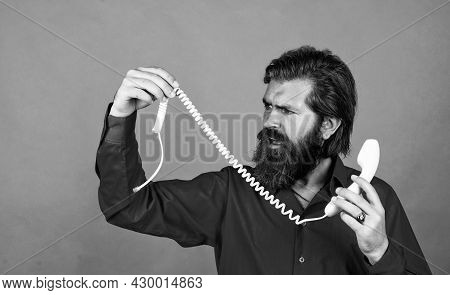 Mature Male Hold Broken Retro Phone. Guy With Beard And Moustache Answering The Call. Telephone Conv