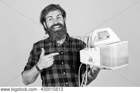 You Cant Live Without It. Man At Home Ironing Clothes. Happy House Husband. Housekeeping. Mature You