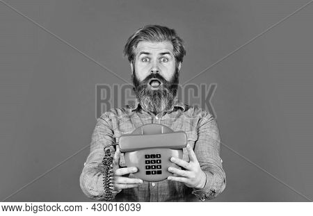 Build Your Brand. Agile Business. Vintage Stationary Telephone. Hello 80s. Man With Moustache Holdin