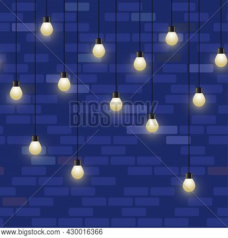 Glowing Light Bulb Garland. Repeated Decorative Lamp Garland On Brick Wall Background. Shiny Lamps,