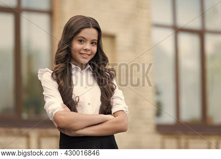 Believe And Achieve. Confident Look Of Cute Child Wearing Uniform. Confident Pupil Keep Arms Crossed