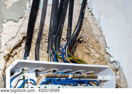 Entry Of Wires Into The Electrical Switchboard On The Wall. Conducting Communications To A Residenti