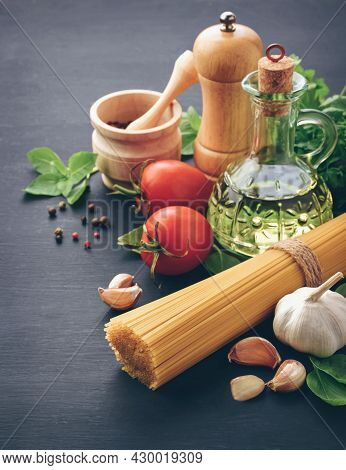 Ingredients For Cooking Pasta Spaghetti Alla Puttanesca - Italian Pasta Dish With Tomatoes, Black Ol