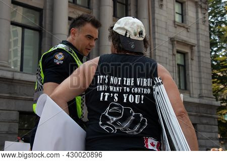 Vancouver, Canada - August 14, 2021:a Man Is Wearing T-shirt  With A Sign It's Not The Virus They Wa