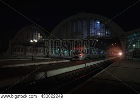 Dusk Of Night Railway Station And Train With Electricity Light Illumination And No People Here Solit