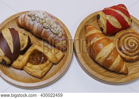 French Pastry Cake- Danish Roll, Scone, Muffin And Croissant Displayed In A Wooden Board
