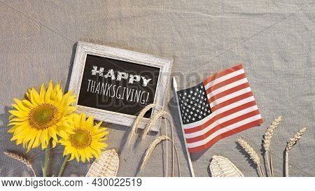 Happy Thanksgiving Text On Blackboard. Banner With Usa Flag, Sunflowers, Wheat Ears, Seasonal Flower