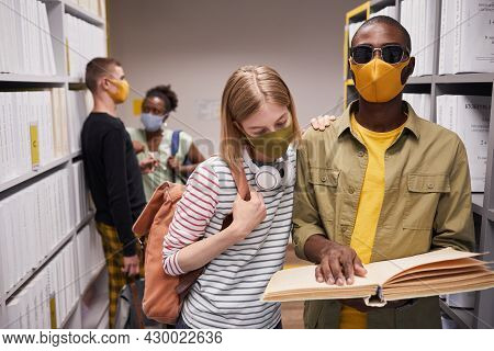 Waist Up Portrait Of Diverse Group Of Students In Library With Blind Man In Foreground