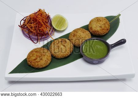 Dahi Kebab, Deep Fried Spiced Yoghurt Patties Rolled With Semolina , Indian Snack Food