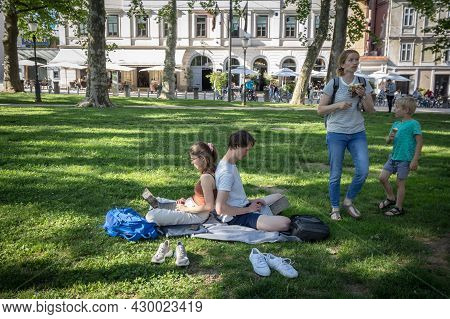 Ljubjana, Slovenia - June 14, 2021: Couple, Lovers, Young Man And Woman, Digital Nomads, Working Rem