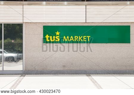 Ljubljana, Slovenia - June 16, 2021: Entrance To A Supermarket With The Logo Of Tus Market. Part Of