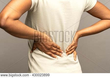 Close Up Of African Woman Suffering From Back Pain, Arthritis, Radiculitis. Black Female Having Musc