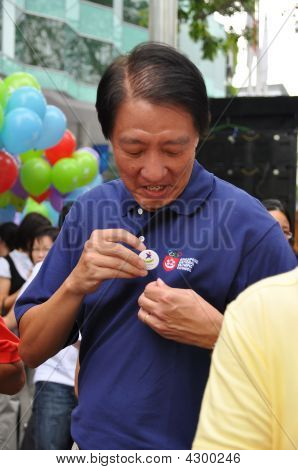 Minister Teo Chee Hean Putting On Youth Olympics Pin