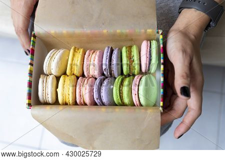 Multicolored Sweet Macaroons Or Macaroon Flavored Cookies In A Paper Box