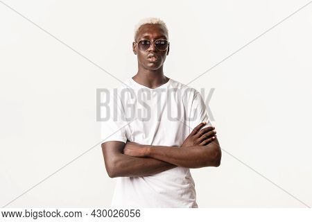 Portrait Of Confident And Serious African-american Blond Guy Wearing Sunglasses And Cross Arms Chest