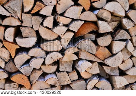 Preparation Of Firewood For Winter. A Woodpile Made Of Birch Wood. Stacks Of Firewood. Copy Space. F