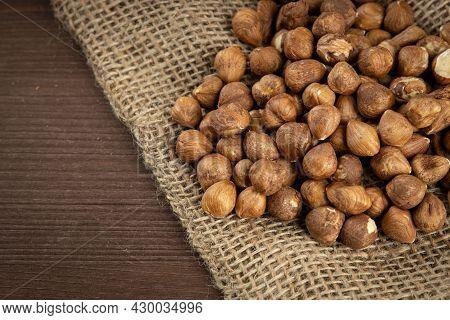 Heap Of Peeled Hazelnuts On Wooden Table
