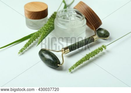 Skin Care Concept With Green Face Roller On White Background
