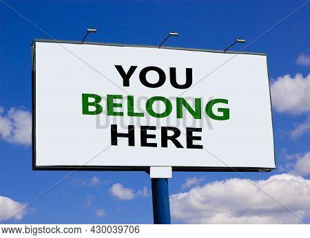 You Belong Here Symbol. Words 'you Belong Here' On White Billboard. Beautiful Blue Sky. Business, Di
